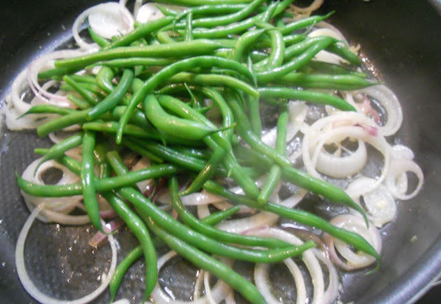 Green Beans Cooking with Onions and Garlic