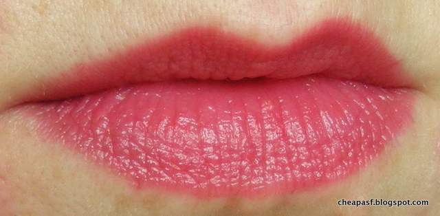 Lip swatch of Wet N Wild MegaSlicks Balm Stain in Coral of the Story