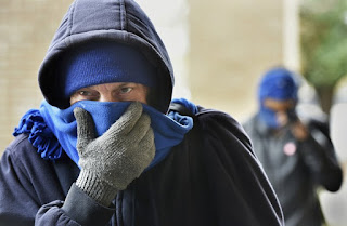 Chris McGuire tries to stay warm as he waits for a space at the City Rescue Mission on Tuesday, Jan. 2, 2018, in Jacksonville, Fla. Dangerously cold temperatures blamed for several deaths have wreaked havoc across a wide swath of the U.S., freezing a water tower in Iowa, halting ferry service in New York and leading officials to open warming centers even in the Deep South. (Credit: Will Dickey/The Florida Times-Union via AP) Click to Enlarge.