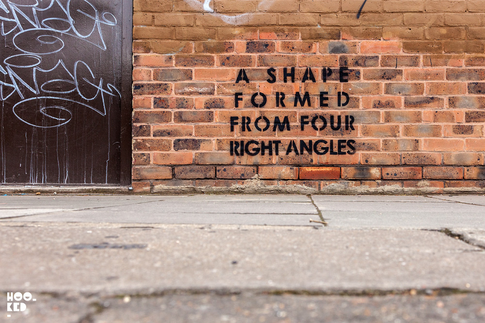 Text based stencil street art in Hackney Wick , London by artist MOBSTR