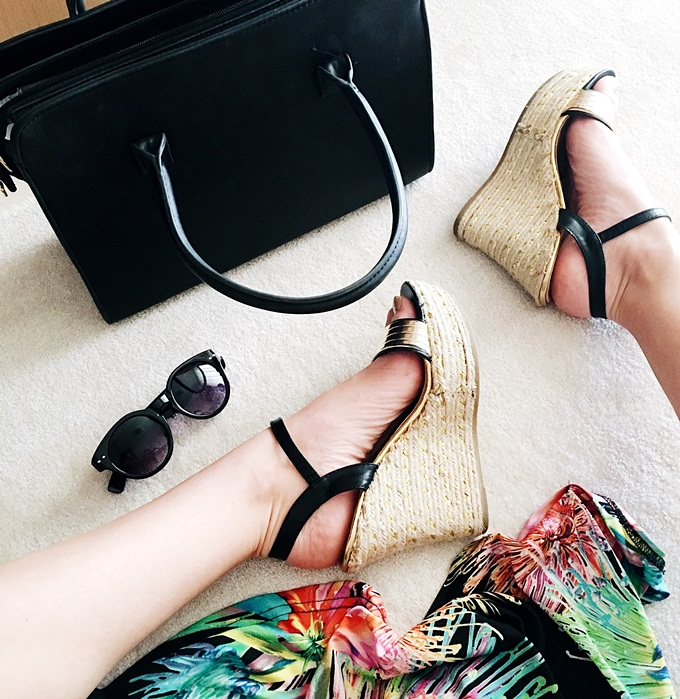 Black and gold wedges.Black bag and shoes.