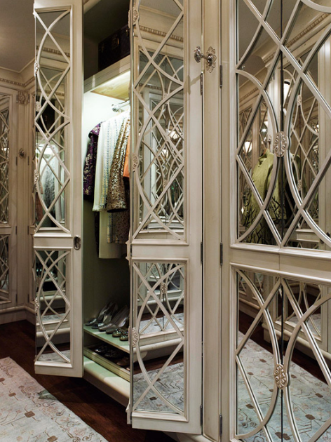 Overhead lighting within the closets makes it easier to see and choose just the right garment.