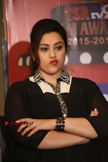 Tamil Actress Meena Latest Stills in Black Dress at TSR TV9 Awards Press Meet  0135.JPG