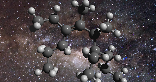 An illustration of the structure of a greasy carbon molecule, set against an image of the galactic centre, where this material has been detected. Carbon is represented as grey spheres and hydrogen as white spheres. Credit: D. Young (2011), The Galactic Center. Flickr – CreativeCommons