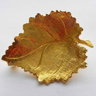 Golden leaf brooch stamped Hollywood