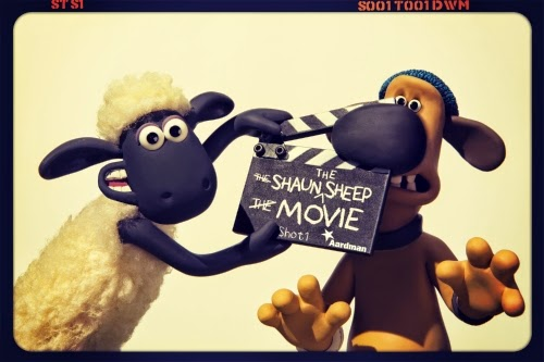 Shaun with a clapper board, and the dog's nose caught in it!