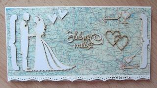 769. Ślubna kopertówka z mapą w tle