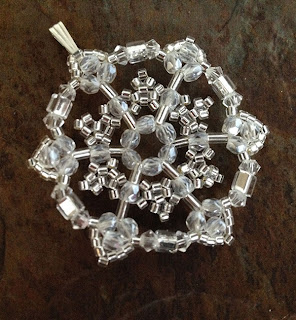 Snowflake Pendant by Julie Dubois, photograph by Karen Williams
