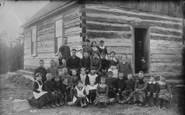 White Pioneer school, teacher and students, Muskoka Lakes, Ontario, 1887