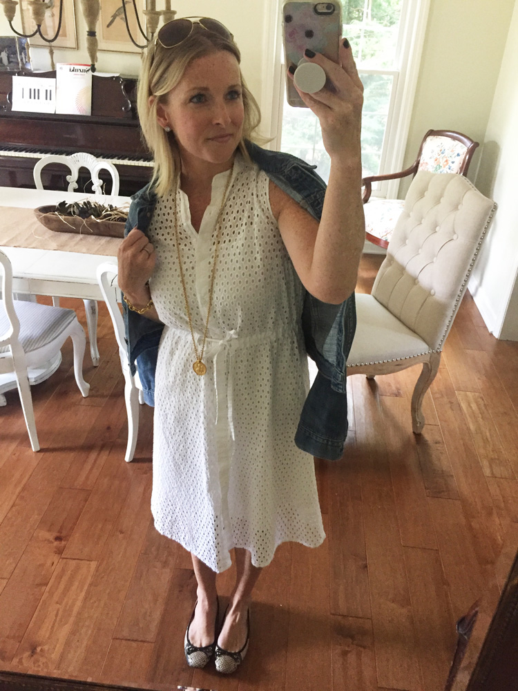 white lace dress with gold pendant