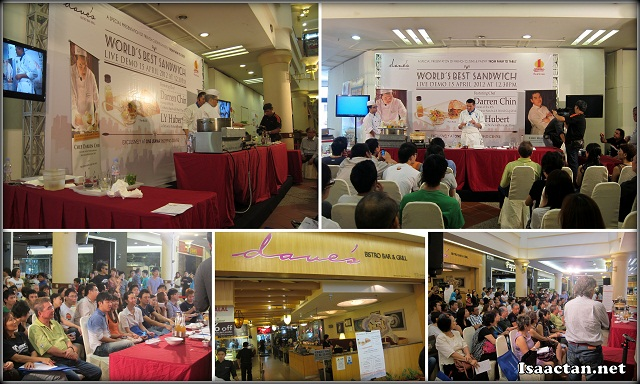 Cooking demonstration in progress in front of Dave;s Bistro in One Utama