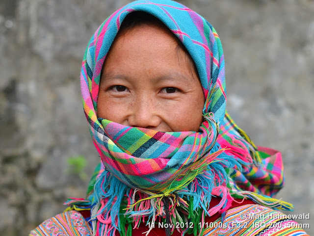 people, street portrait, headshot, face, eyes, headscarf, face bandana, Vietnam, Can Cau market, market woman, hill tribe, Flower H'mong, eye contact