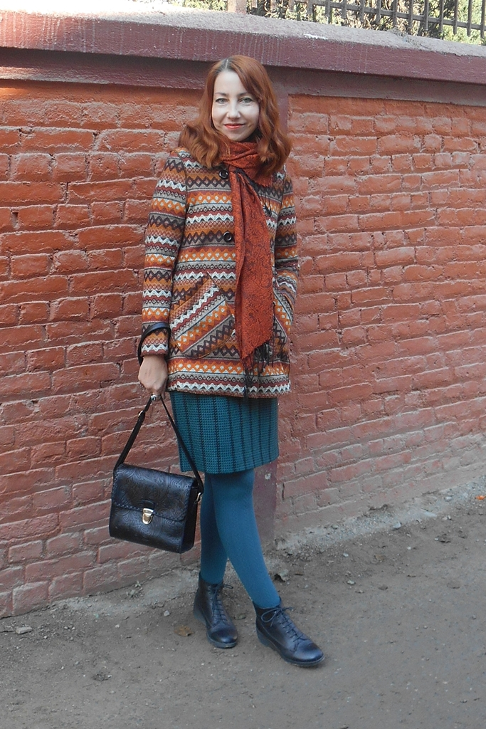 Printed coat with turquoise skirt and tights and copper scarf