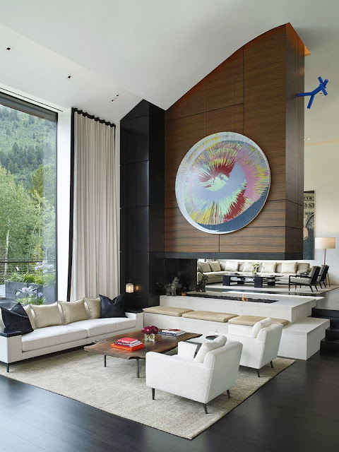 Living room of Aspen Residence by Stonefox with white chairs and couch along with fireplace