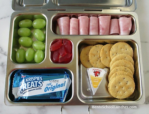 Ham roll ups, laughing cow cheese, crackers, grapes for lunch in Planetbox
