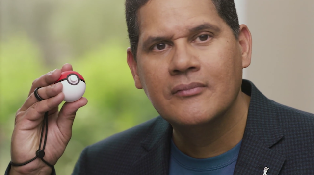 Reggie Fils-Aime with Poké Ball trainer ready to battle Nintendo Direct E3 2018