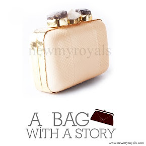 Queen Mathilde style A Bag With A Story Clutch