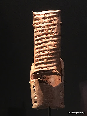 small clay tablet with cuniform writing