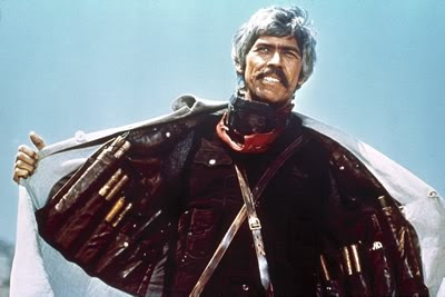 James Coburn as IRA dynamite expert and revolutionary John H. Mallory in Duck, You Sucker!, wearing dynamite jacket, Directed by Sergio Leone