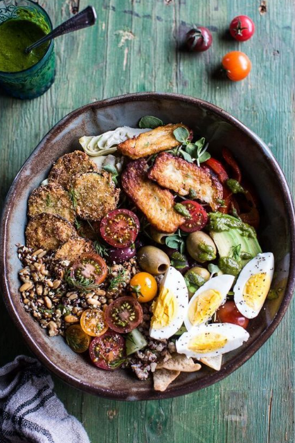 greek goddess grain bowl with fried zucchini, toasted seeds and fried halloumi