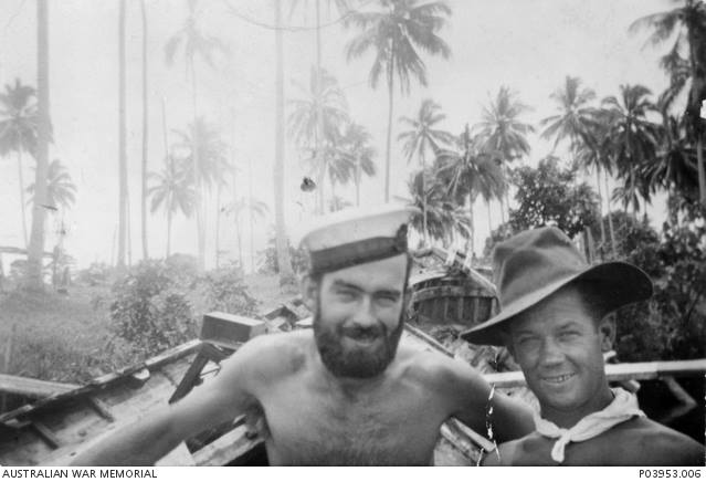 Informal portrait of PA/2957 Telegraphist Ronald James Reynolds (left) and Leading Seaman Clayton at Coast Watcher Camp Alexhafen, New Guinea, just prior to the ill fated raid on Muschu Island, off the coast of New Guinea, on 11 April 1945.