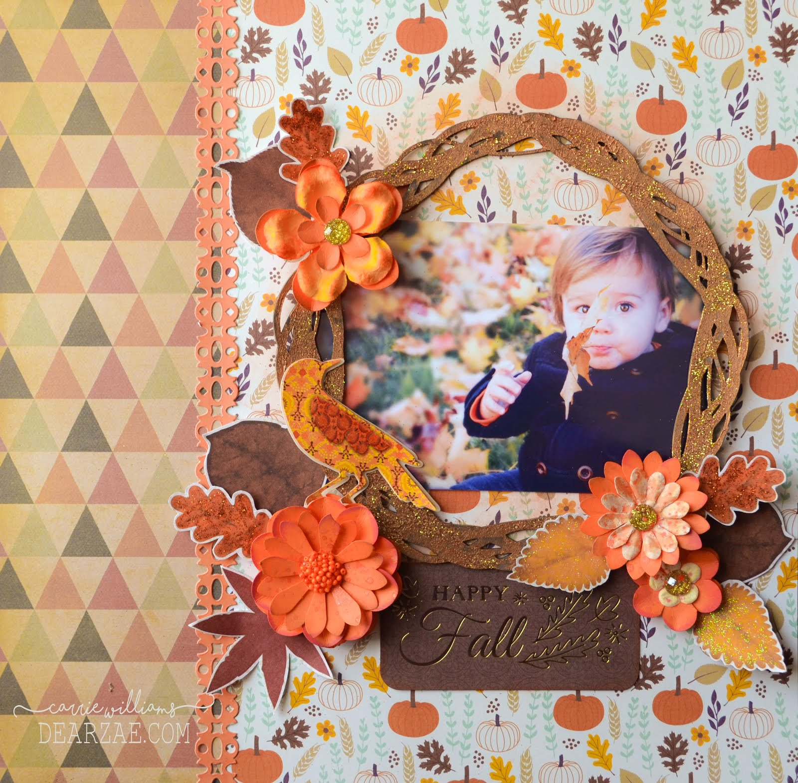 Happy Fall autumn October scrapbook layout in orange and gold with pumpkins, die cuts, handmade flowers, fussy cut leaves, chipboard wreath frame