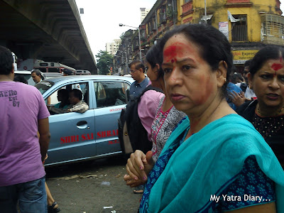Red mark on the foreheads of devotees at the Lalbaugcha Raja Ganpati Mandal
