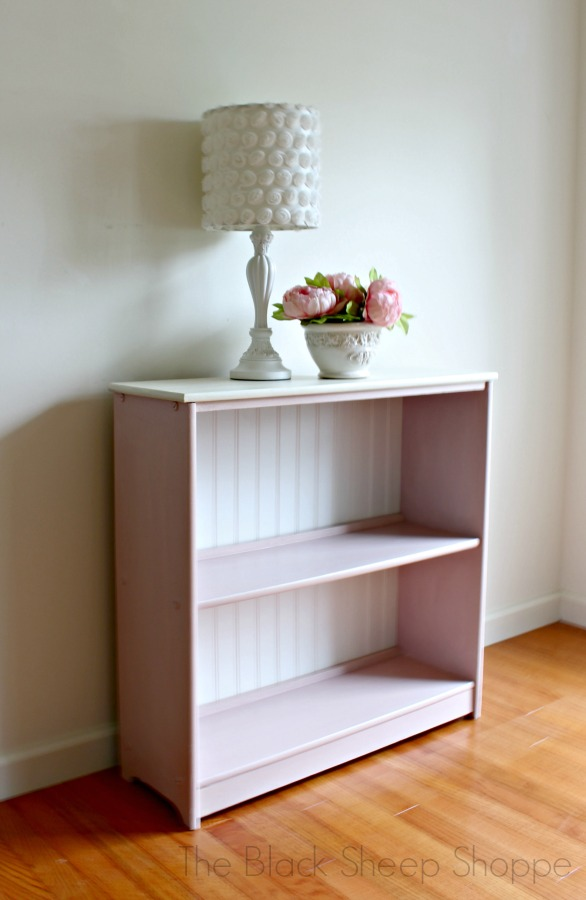 Bookcase painted in Antoinette Pink and Old White.