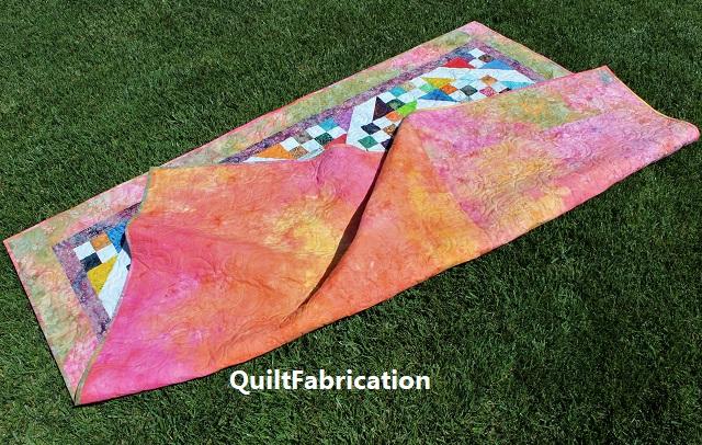 orange batik quilt back