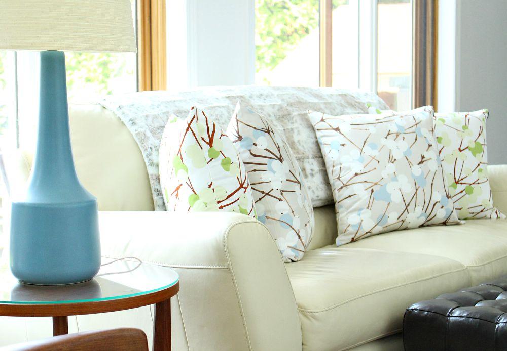 Cream leather sofa, Lumimarja pillows