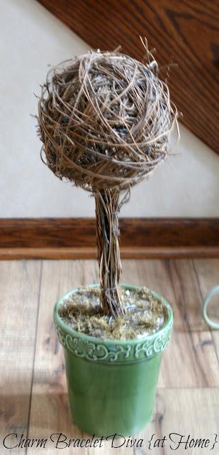 green ceramic flower pot reindeer moss grapevine ball topiary