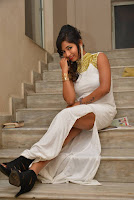 Actress Ishita Latest Stills in White Long Dress at Ippatlo Ramudila Seethala Evaruntaarandi Babu movie Audio Launch  014.jpg