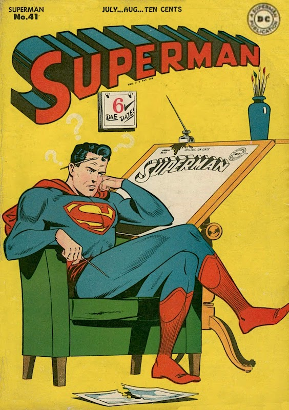 Superman cover with the hero sitting pensively by a drawing board with large white question marks above him