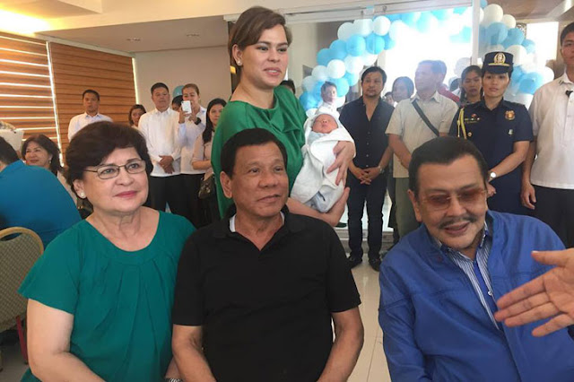 Duterte Shows His More Tender Side as He Poses with His Grandson 'Stonefish' During Baptism Reception
