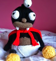 http://www.ravelry.com/patterns/library/nibbler-guardian-of-the-bum-fodder