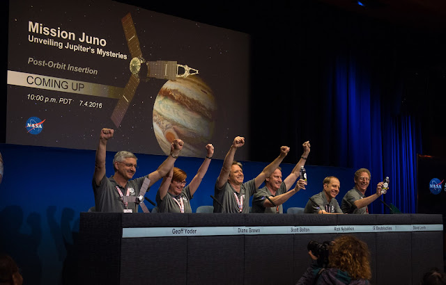 Members of the Juno team celebrate at a press conference after they received confirmation from the Juno spacecraft that it had completed the engine burn and successfully entered into orbit around Jupiter, Monday, July 4, 2016 at the Jet Propulsion Laboratory in Pasadena, CA. Credit: NASA/Aubrey Gemignani