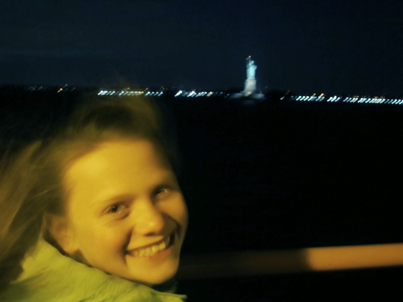 young giel smiling, New York, Statue of Liberty