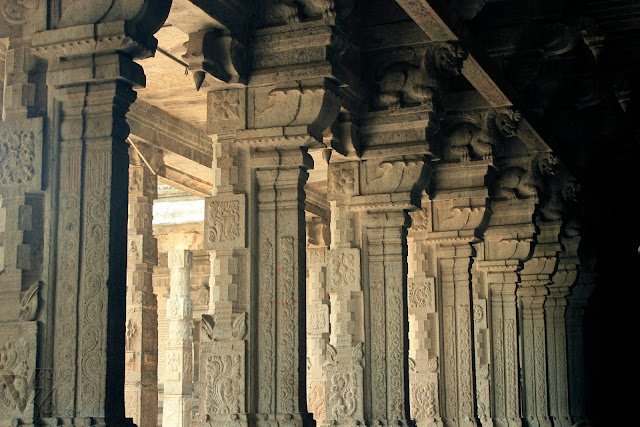 The elegantly carved colossal monolithic stone columns inside the temple