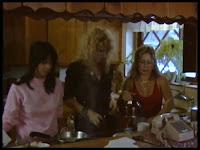 Screen shot featuring Belma Kora aka Sema Kora from BOARDINGHOUSE (1982), shot at 20950 Ave San Luis in Woodland Hills, California