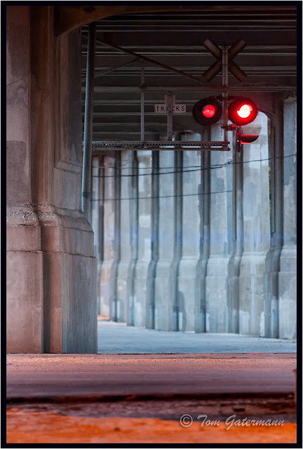 Crossing signals flash under the 12th Street Viaduct in the West Bottoms of Kansas City.