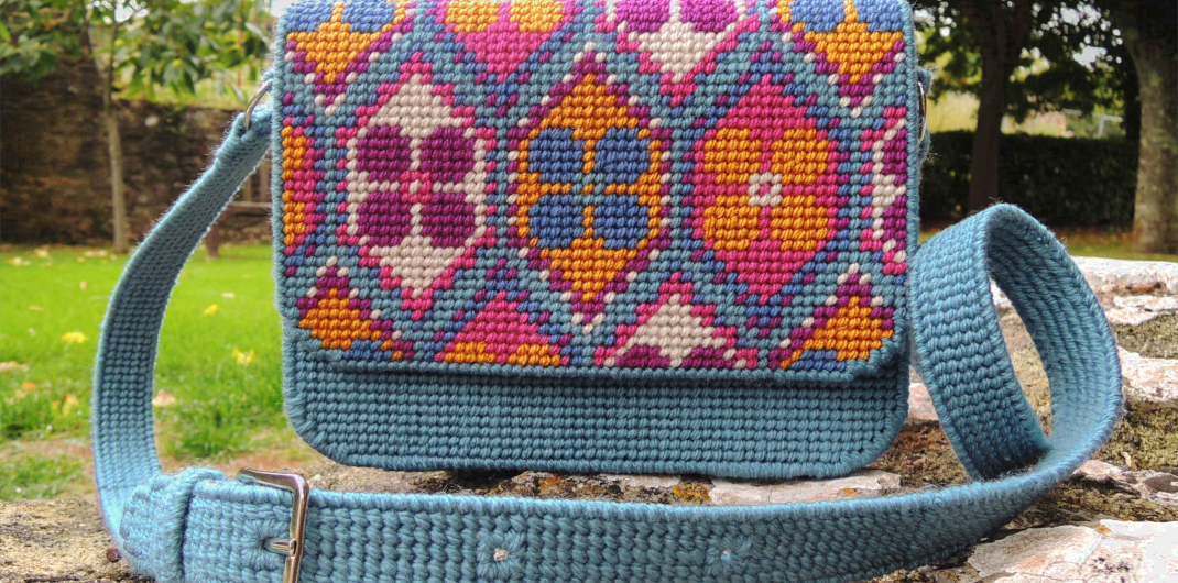 Boho needlepoint satchel with geometric repeat pattern by Bobbin and Fred