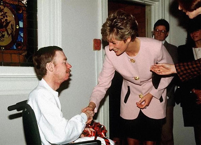 Princess Diana shaking hands with one of the residents of Casey House, an AIDS hospice, in Toronto, Canada.