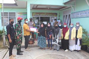 Penyemprotan Desinfektan oleh mahasisa KKN Universitas Negeri Padang