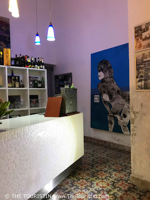 The interior, the art and the tiled floor of the restaurant Opera in Vedado in Havana in Cuba