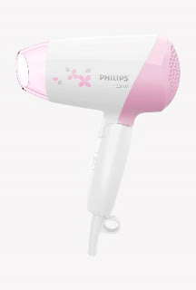 Philips hair dryer to style her hair