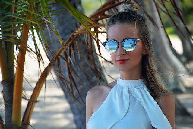 reflective silver sunglasses palm tree reflection