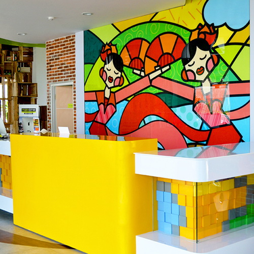Tinuku Ivanna Cerelia Suryo studio gives bright graphic design on wall Maxone Hotel in Sukabumi as cheerful touch