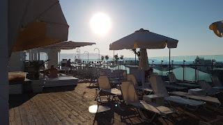 Clothes & Dreams: 48 hours in Crete, Heraklion. Capsis Astoria Hotel roof pool bar.