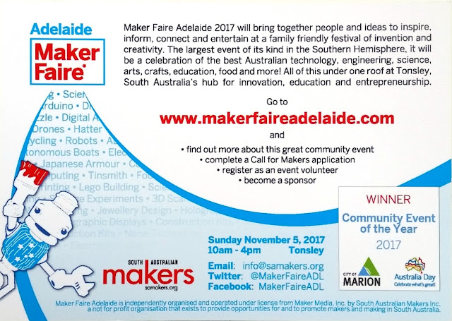 "The back of the Maker Faire postcard. Mascot ""Sam"" the robot is in the bottom left corner holding up a paintbrush daubed with red paint. Top left corner has the heading ""Adelaide Maker Faire"". Next to the heading is the following black text on a white background quoted in the body of the blog entry. Maker Faire Adelaide's web site address is in bold red letters in the centre. From the heading, a curve bordered by two blue bands sweeps down towards the bottom of the card and then up again towards the right edge. Some of the words within the blue section are: Science, Arduino, Digital A.., Drones, Hatter, Robots, ..tonomous Boats, Japanese Armour, Tinsmith, Computing, Lego Building, Experiments, 3D.., Jewellery Design, Hologram..words fade into a screen of pale blue onto which the followoing details are printed: South Australian Makers logo, samakers.org, Sunday November 5, 2017 10am-4pm Tonsley; Email: info@samakers.org; Twitter: @MakerFaireADL; Facebook: MakerFaireADL; A box on the bottom right says ""WINNER Community Event of the Year 2017 - City of Marion (logo), Australia Day Celebrate what's great (logo)"