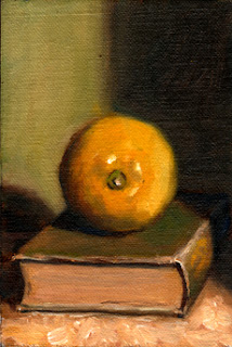 Oil painting of a lemon on an old green linen-bound book.